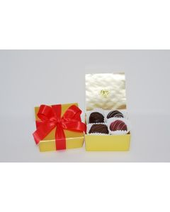 Gold Four piece Box with Red Bow